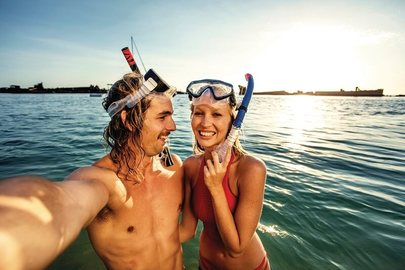 couple snorkeling at moreton island