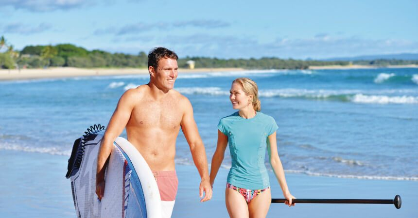 couple walking at noosa beach