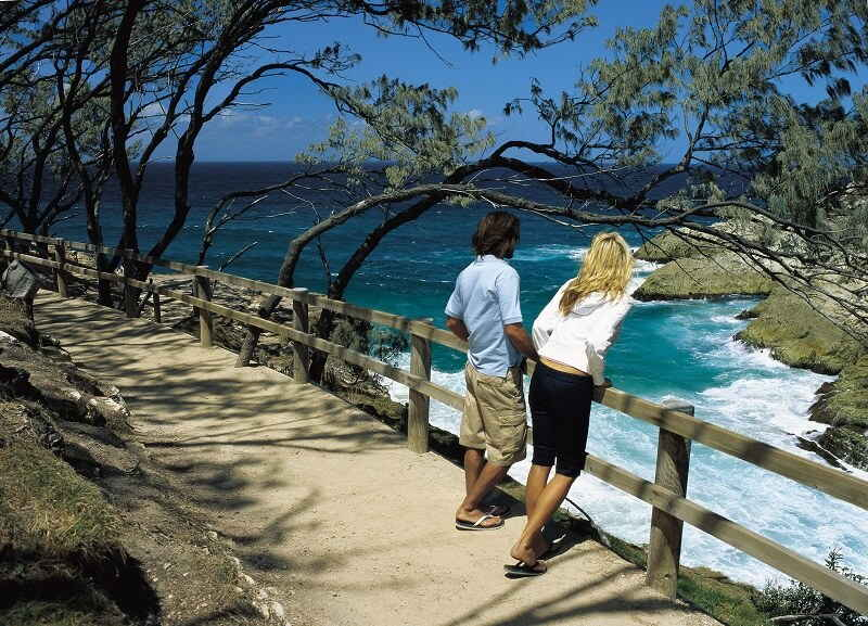 couple walking on north stradbroke island